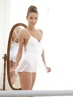 Alexis Crystal does whatever it takes to keep her body tight and fit so that it looks incredible in a leotard. She does her stretches with the barre and is just about to start practicing her routine when her coach Michael Fly joins her. His gentle caresse