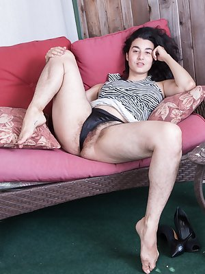 Wara strips naked and has fun on her red couch