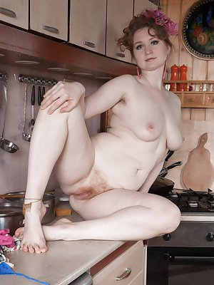 Bazhena is hanging around in her kitchen in her blue apron and sexy dress. She undresses and lets us peek at her hairy pit. She then shows off her hairy pits while sitting on her kitchen counter.