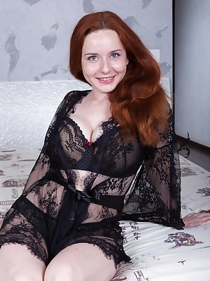 Elouisa is in bed wearing all black today. Her lingerie slides off her body and she spreads her legs to show her hairy pussy. She has flowing red hair and her hairy bush is fire red as well.