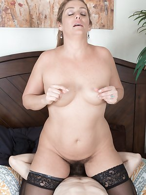 Alicia Silver sees her man on her bed and he starts undressing her and eating her hairy pussy. She sucks his hard cock and he fucks her hairy bush until she gets super moist, and cums all over her.