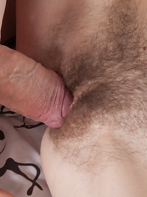 Christy is in her bedroom with her man and they get horny. He strips her naked and touches her hairy pussy. He licks her hairy pussy after a blowjob, and fucks her hairy pussy hard and often.