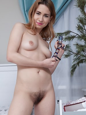 Nara Abel has awakened from bed and is horny. Wearing her black lingerie, we can see her hairy pits and hairy pussy. She starts masturbating with her glass dildo and fucks her pussy deeply and often.