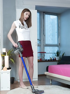 Lillian Vi is cleaning up for the day, and is horny. She strips off her blue top and red skirt and unwinds on the carpet. She gets her black vibrator and masturbates while fucking her pussy.