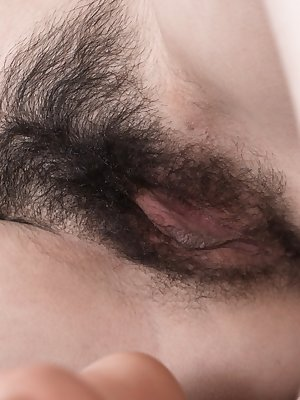 Ornella takes off her black blouse and blue skirt, and has a sexy 19 year-old body and a hot hairy pussy. She climbs on her commode, and bends over to show her pussy and then masturbates to orgasm on it.