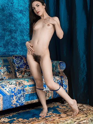 Luna O loves her blue chair, and takes off her blue blouse and peach shorts to enjoy it. She trips and shows her hairy pits and hairy pussy, while posing naked on the couch in her natural beauty.