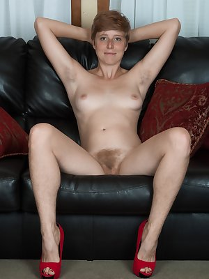 "Aurora Odaire is on her leather couch in a red dress reading a book. She strips after done reading and shows her hairy pits and pussy. She is sexy and 5'8"", and has a beautiful hairy bush to enjoy."