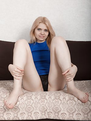 "Amuza takes off her new blue dress and lays back to show her hairy pussy. She has a 5'6"" natural Ukrainian body, and long hairy with perfect breasts. But, her full hairy pussy really gets our looks."
