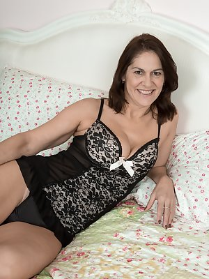 Kaysy is 52, and a ravishing mature natural beauty. She strips off her black bath robe in bed, and displays her 34D natural breasts and hairy pussy. She touches and caresses herself all over in bed.