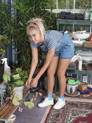Candy Wallace enjoys gardening in her denim overalls. She has hairy pits and a hairy pussy that grows quickly. She finds a quiet spot to strip naked, and then shows off her young figure and hairy bush.