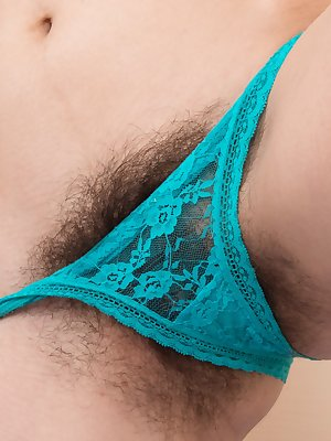 "Halmia is sexy in blue and strips naked on her blue bed. The dress and green lingerie come off, and she lays naked. Her 5'10"" body has hairy pits and a sexy hairy pussy, and she looks amazing naked."