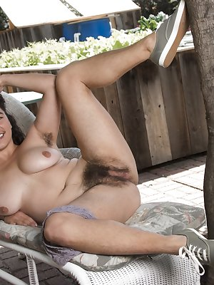 Serai is outdoors in her overalls and lingerie. She shows all her hairy pits and hairy legs while posing. Undressed, her hairy pits and hairy pussy are on display and she takes time showing her pink pussy.