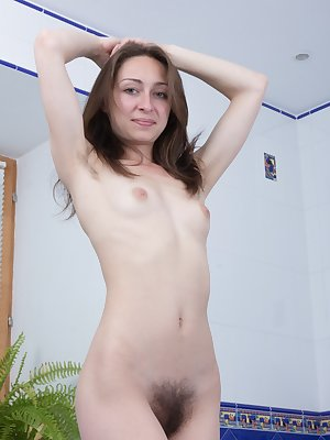 Entering her bathroom, Morana is eager to get clean and wet. The blue dress and lingerie come off, and she poses to show her hairy pussy and pits. In the tub, she soaps up and rinses off her natural body.