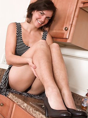 Katie Z loves the kitchen and it shows. She slides off her grey dress and black lingerie to show her hairy body. Her hairy pussy and hairy legs are sexy, and she loves to show it all off for all.