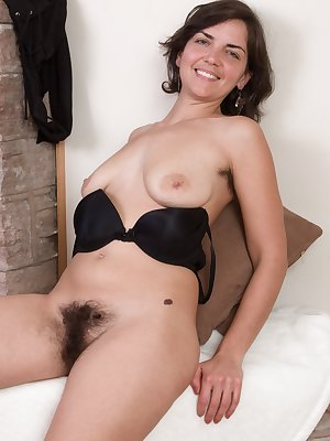 Doesn't Katie Z look hot in black? She shows us her hairy pits and hairy pussy early, and its all a sexy show from there. Her all-natural body flows in beauty, as she bends over and shows more off.