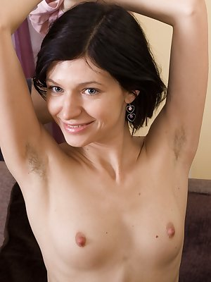 Efina meets her man on her brown sofa. Sensual kissing leads to her giving him a wonderful blowjob. He is hard and horny, and fucks her hairy pussy deeply. He continues until finishing on her pussy.