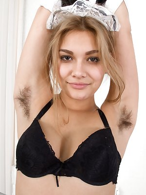 Baby Lizza enjoys cleaning and wears her favorite cleaning outfit. She takes it off, while showing her hairy pits and hairy pussy. She finds oil and then rubs it all over her slender all-natural body.
