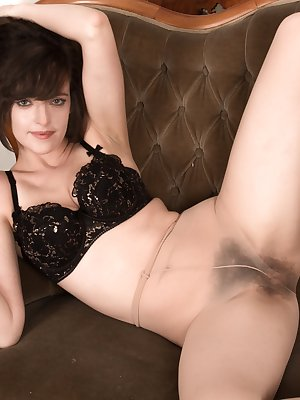 Kate Anne is elegant and delightful and wears her evening dress mixed with stockings. Undressing, the stockings come off to disclose her hairy pussy. Laying back, her all-natural body shines in beauty.
