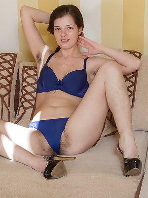Blue lingerie is one of Lima's favorites, and she loves to strip naked. She has hairy pits and an inviting hairy pussy. But, enjoy as she climbs on her couch and shows off her hairy pussy and delightful body.