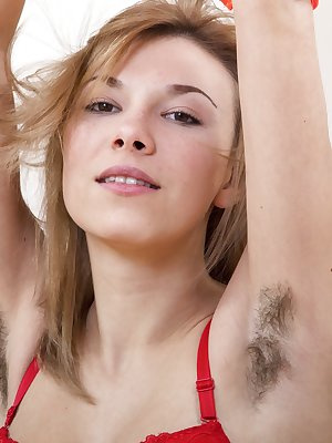 Alisia is a young sexy Ukrainian with a sexy all-natural body. In her denim shorts, she shows off her hairy legs and body. Stripping to her lingerie and naked, she shows off her hairy pits and hairy pussy.