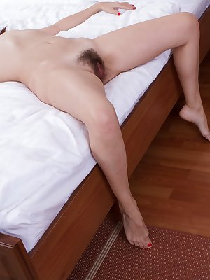 Vesta plays a sexy Santa and wears sexy stockings for her man. She strips naked for him and he fingers her hairy pussy. Great blowjob skills and hardcore fucking leads to her pussy covered with his cum.