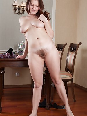 Lena Lake wears a hot dress and as she undresses, shows off her hairy pits. She gets nude and shows her very hairy pussy. She fingers her pink pussy lips and enjoys herself. Her sexy figure and tits are sexy.