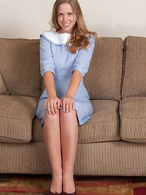 April in her blue dress and white collar looks great with her long hair. She is sassy and her pink panties show it off perfectly. She strips and fingers her hairy pussy and sweet pink pussy underneath.