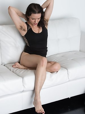 Sexy Lucia is in a hot black dress, and she shows off her hairy pits which makes her sexier. In her black heels, she is hot. But, as she strips naked and plays with her hairy pussy is gets even hotter.