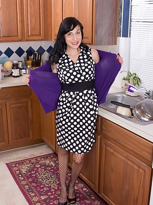 While wearing a polkadot dress, Lucy Dutch is in the kitchen in sexy stockings. Her fishnet stocks look hot, but naked her hairy pussy is the vision. She uses several kitchen toys to masturbate there.