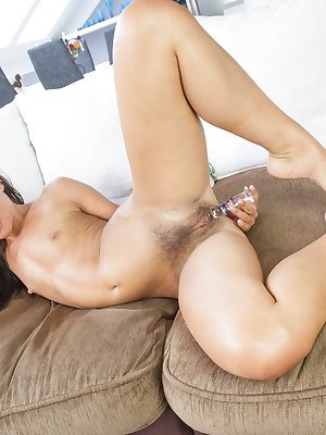 After a long workout, hairy brunette Promesita enjoys coming home and stretching. She stretches and strips. She knows her hairy pussy is wet so she grabs her dildo and masturbates herself too.