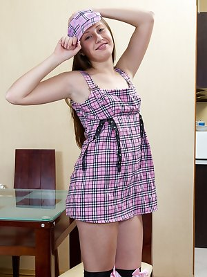 Flora is a sexy brunette babe still in her school girl uniform as she sits at home and slowly strips out of her clothes in the dining room. And then shows off her sexy nude body and hairy pussy.