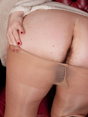 Sharlyn is a new hirsute model and loves it. She loves sitting in the buttery soft leather chairs and showing her delicious pussy. She loves the feeling she gets when she slowly strips and poses.