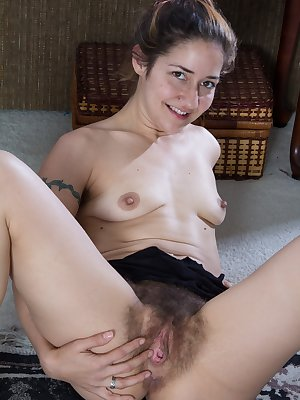 As hairy woman Isabel gets ready to exercise, she loves to stretch. As she stretches, she gets distracted and starts to touch herself. She starts to play with her pulsing pussy and loves the feeling.
