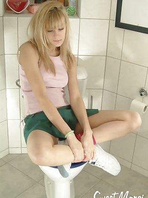 Marci in the bathroom plays with herself