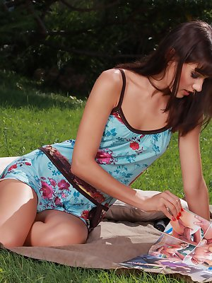 Sexy brunette fucking her pussy with a dildo outdoors