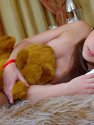Adorable brunette teen spreads sweet shaved pussy