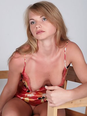 Sweet blonde babe flaunts pussy on chair