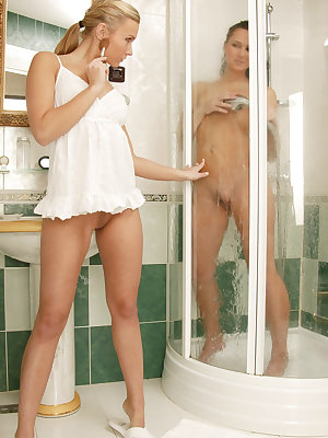 Gorgeous nude lesbians showering together
