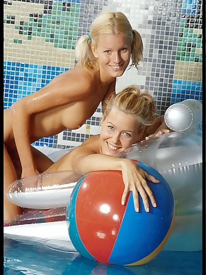 Lesbian girls hanging out naked on pool side