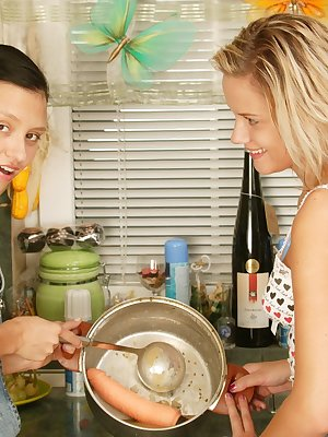 Two hot teens in the kitchen playing with cream