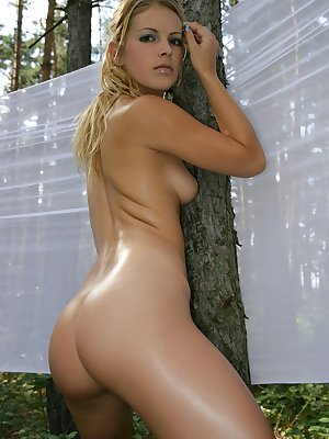 Blonde babe having fun outdoors