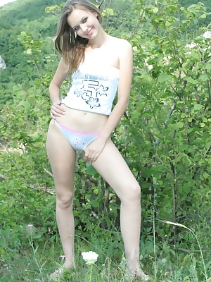 Cute teen strips to reveal her sweet body outdoors