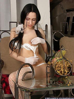 Sitting at the table stripping out of her cute white lingerie