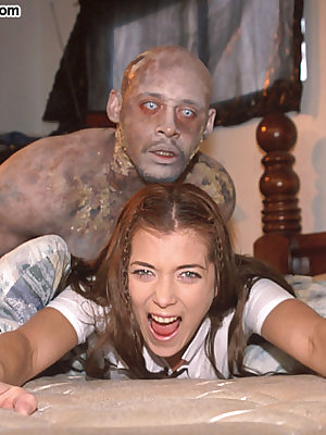 Two zombies prey on a horny schoolgirl