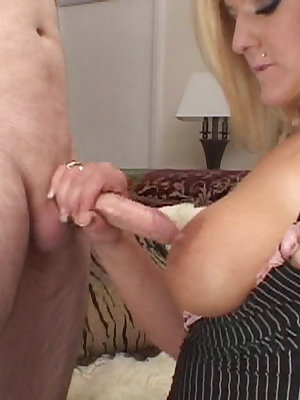 Sexy blonde gives a handjob and eats up cum
