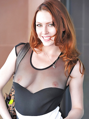 Cute amateur redhead shows off her juciy twat and her tits in public