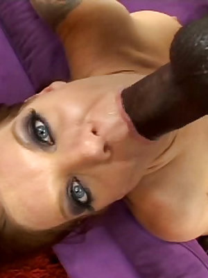 Redheaded honey gets a huge black dick stuffed in the ass