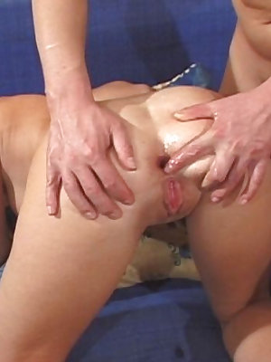 This blue couch sees plenty of action as a hot brunette is fucked in the ass