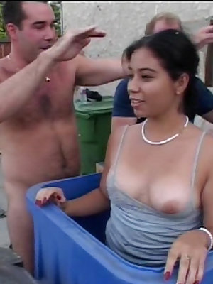 Latina cutie pops out of a box to suck two cocks