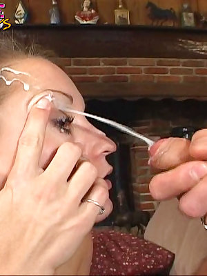 A projectile stream of jizz hits this slut in the eye